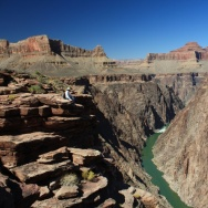 The eastern Grand Canyon was about half-carved (to the level of the red cliffs above the hiker) from 15 million to 25 million years ago, an analysis published Sunday suggests. But the inner gorge was likely scooped out by the Colorado River in just the pa