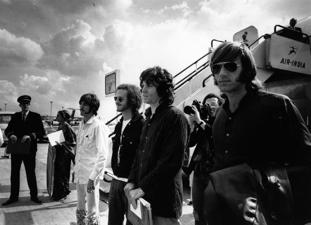 File: American rock group The Doors arrive at London Airport in 1968. From left to right: John Densmore, Bobby Krieger, Jim Morrison and Ray Manzarek.