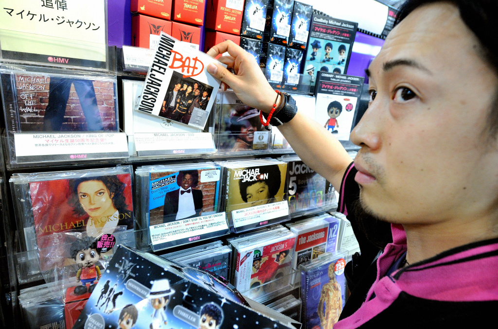 HMV salesclerk Yoshio Nishimura arranges CD's by US pop legend legend Michael Jackson in Tokyo on June 26, 2009 following the news of his death in Los Angeles.