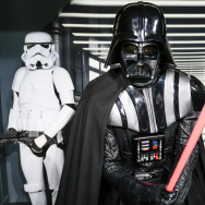 A wax figure of the Star Wars characters Darth Vader (C) and two Stormtroopers are displayed.
