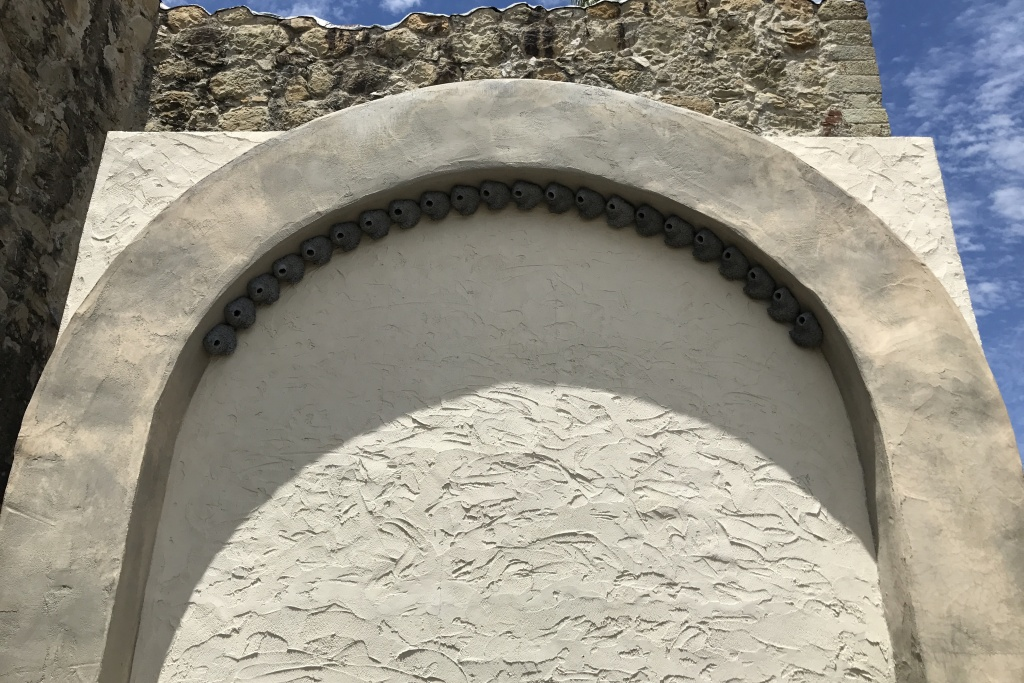 Biologist Charles Brown lined a wall at the mission in 2015 with imitation, plaster cliff swallow nests in hopes of luring the birds back. The nests remain unused.