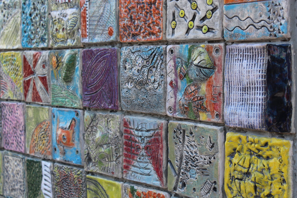 Kids with and without special needs worked together to design the ceramic tiles that make up this mural.