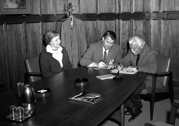 Mr. and Mrs. Arthur Fiedler of the Boston Pops Orchestra and Dr. Wernher von Braun in his office during the Fiedlers' visit to the Marshall Space Flight Center on March 23, 1962.