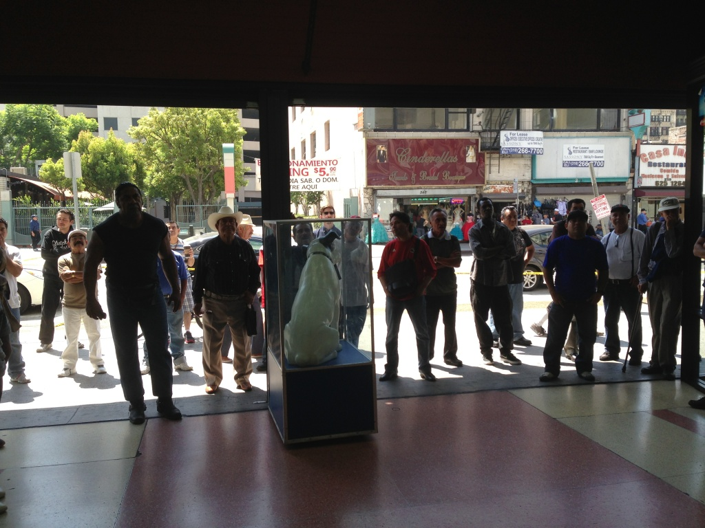 Fans of the Mexican national team watch Sunday's World Cup match against the Netherlands outside a downtown L.A. store. The owner had set up a television facing the street.