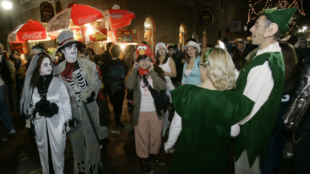 Goblins mix with elves in less scary times, celebrating Halloween in Salem, Mass., in 2007.