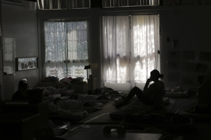 Staff at Young Horizons watch over preschoolers as they take their afternoon nap.