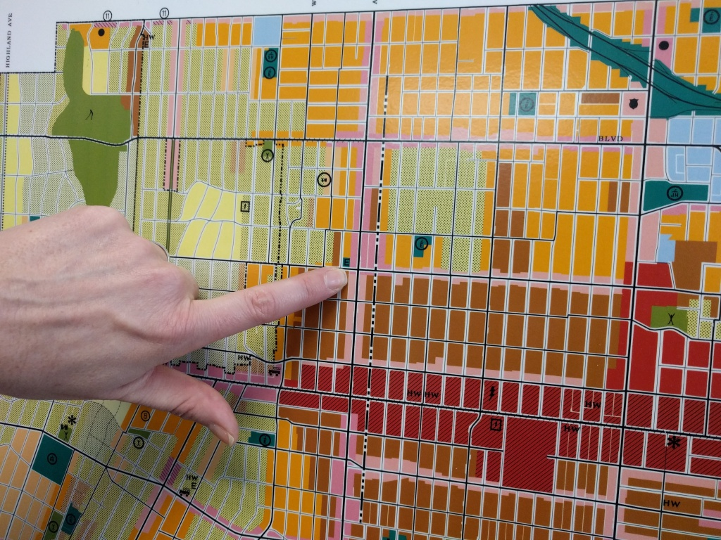 LA's principal planner Shana Bonstin points out the corner of Western and 6th St on the zoning map for Wilshire/Koreatown. The map was made in 2001, but the area has already gone through dramatic population changes since that time.