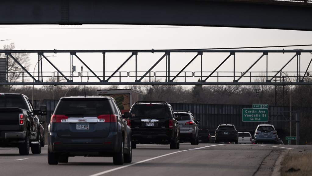 Vehicles drive on highway I-94 in St. Paul, Minn., on Nov. 7, 2020. A recent report from the International Energy Agency said emissions fell across most parts of the economy, with one notable exception: SUVs.