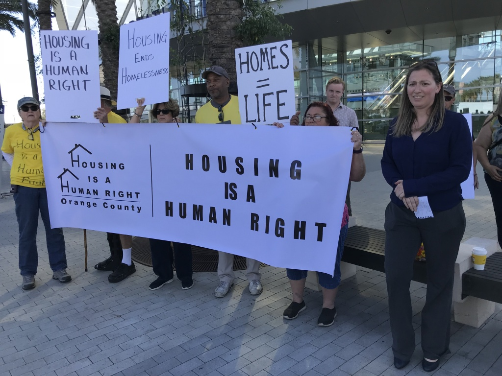 Attorney Brooke Weitzman, flanked by advocates for the homeless, announces a federal lawsuit against Orange County and the cities of Anaheim, Costa Mesa and Orange on Jan. 29, 2018. Advocates have long criticized the region's approach to homelessness, including the county's failure to spend local funds on housing the homeless.