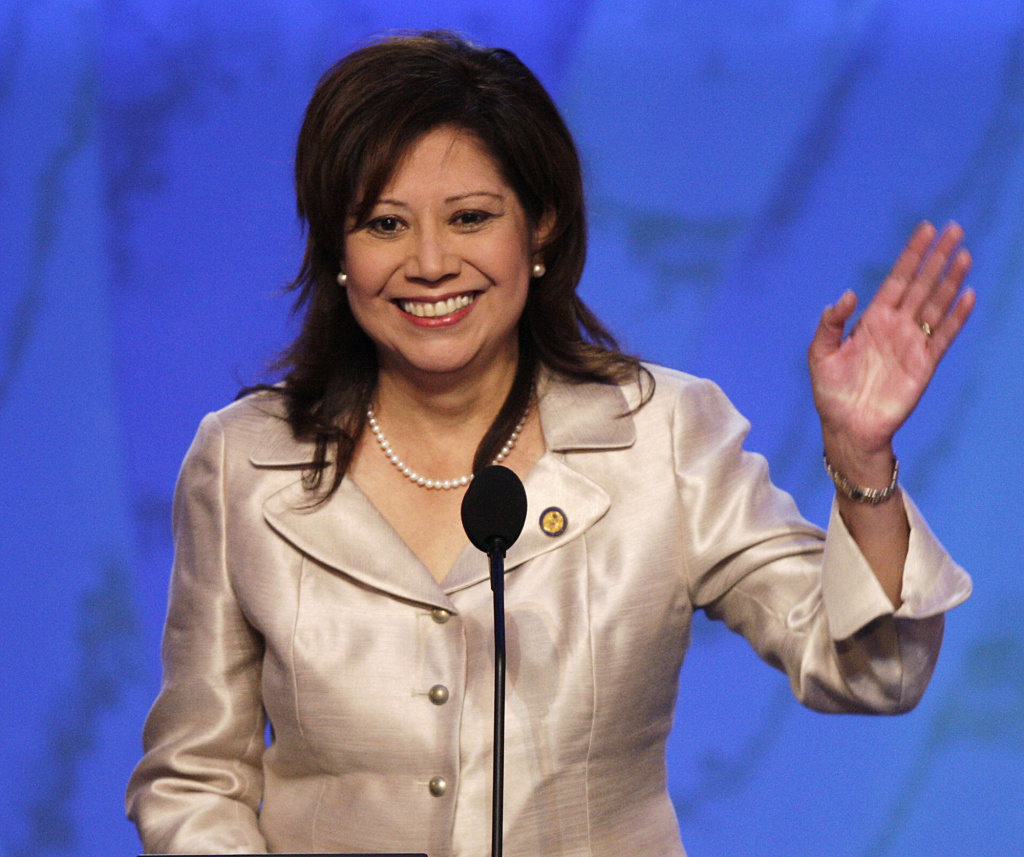 FILE - In this Aug. 27, 2008 file photo, then-Rep. Hilda Solis, D-Calif., waves as she speaks at the Democratic National Convention in Denver. One current and three former female members of Congress tell The Associated Press they have been sexually harassed or subjected to hostile sexual comments by their male colleagues while serving in the House. Solis, now a Los Angeles County supervisor, recalls repeated unwanted harassing overtures from one lawmaker, though she declined to name him or go into detail. (AP Photo/Ron Edmonds, File)