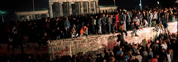 Thousands of young East Berliners gathering at the Berlin Wall, near the Brandenburg Gate (background) in this picture taken on Nov. 11, 1989. During the summer of 1989, 10s of thousands of East Germans fled the communist regime to a new life in the west.