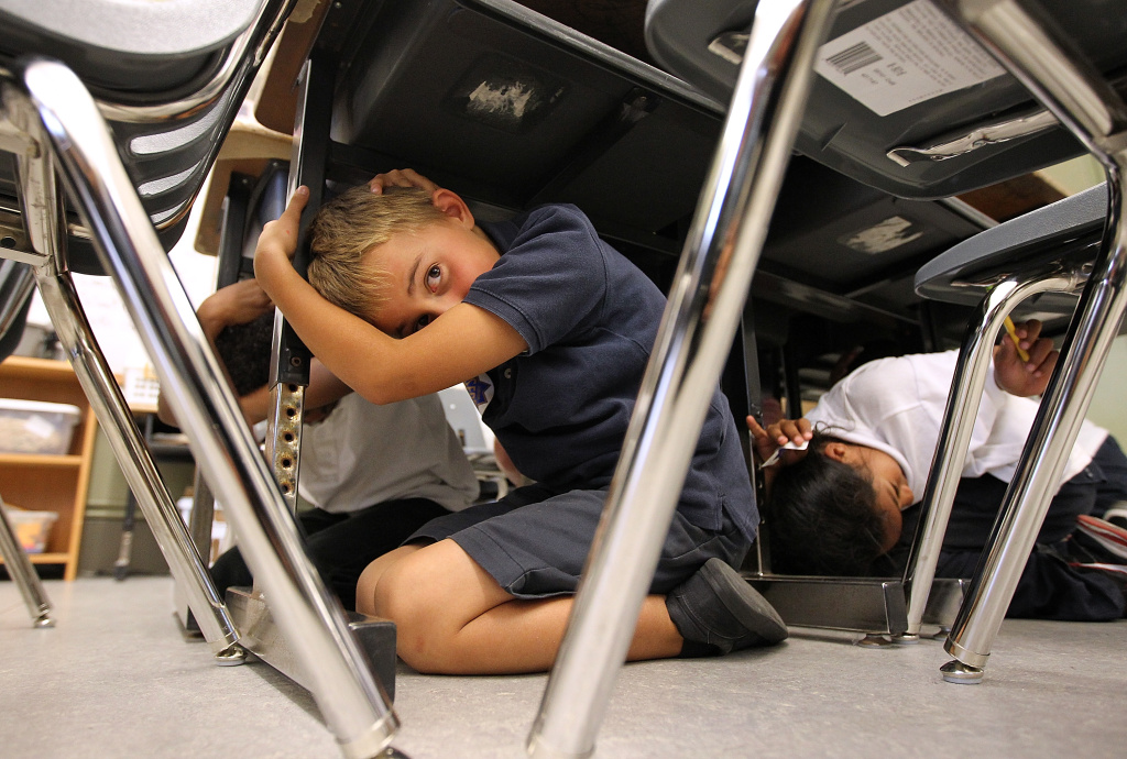 SAN FRANCISCO, CA - OCTOBER 20:  Third grade students at William L. Cobb Elementary School take cover under desks as they participate in the