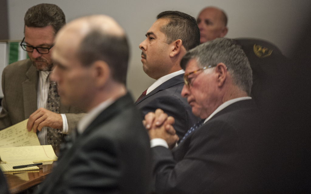 Defendant Manuel Ramos, third from right, listens to proceedings in his trial on charges stemming from the beating and death of Kelly Thomas.