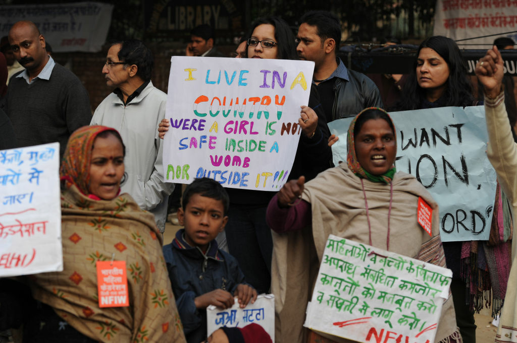Indian protesters hold placards during a rally in New Delhi on December 31,2012. The family of an Indian gang-rape victim said they would not rest until her killers are hanged as they spoke of their own pain and trauma over a crime that has united the country in grief.