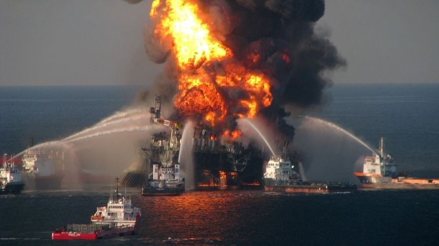 The Deepwater Horizon oil rig burns in the Gulf of Mexico in April 2010. The rig's crew were new to their positions just before the explosion. Such staffing reorganizations are increasingly common as the industry grapples with a staffing shortage.