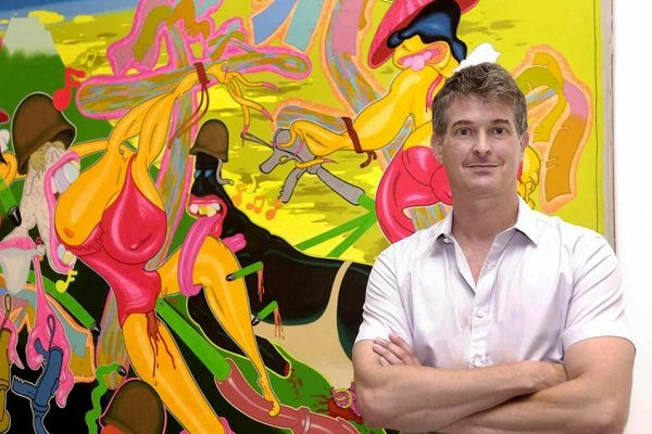 Orange County Museum of Art curator Dan Cameron in front of Peter Saul's