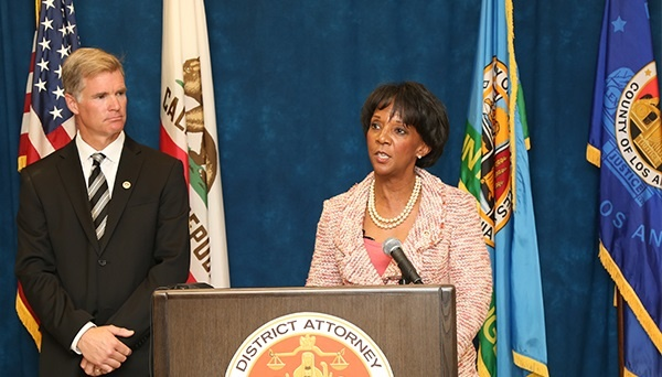 File: District Attorney Jackie Lacey briefs the media on the Conviction Review Unit while Assistant Head Deputy Kenneth Lynch looks on.