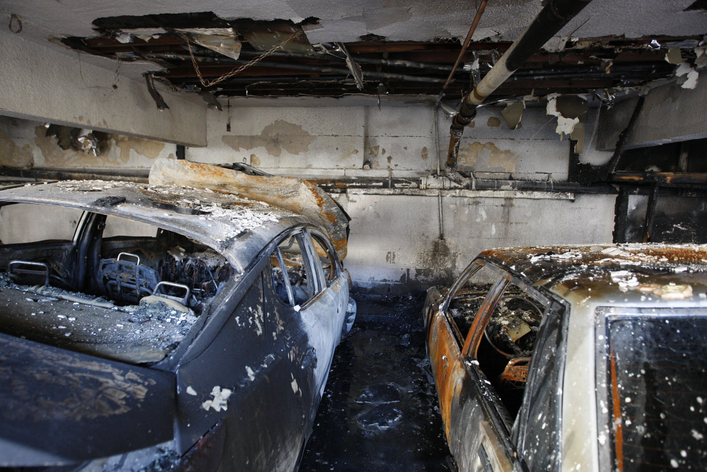 Cars that were burned in a spree of arson fires lie in ruins in Los Angeles Jan. 2. Police have taken a suspect into custody whom they believe was responsible for setting more than 50 fires over the weekend.