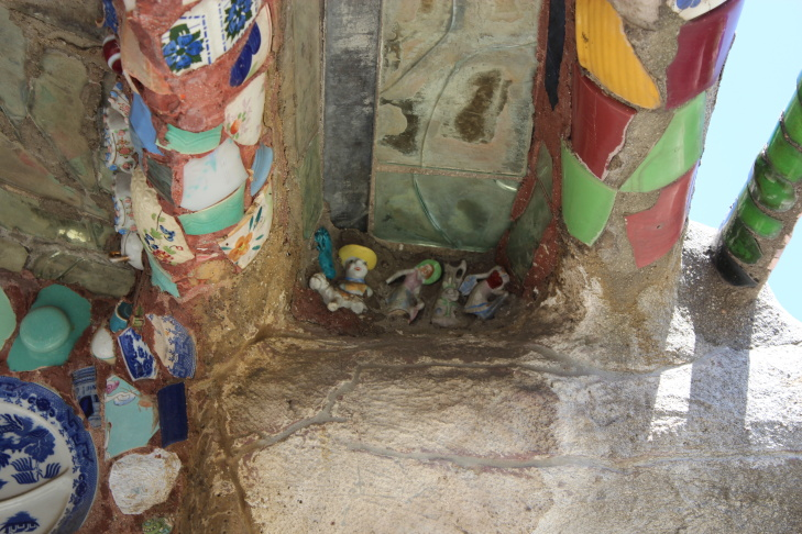Figurines inside the doorway of the Watts Towers