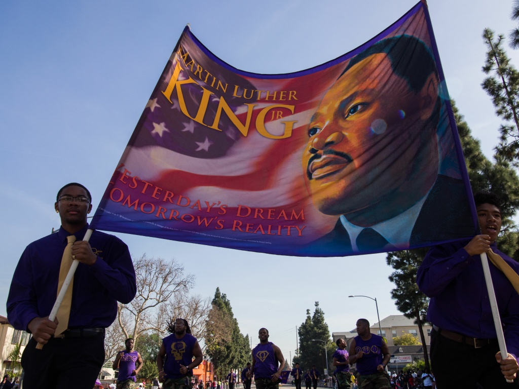 Participants march in the 33rd annual Kingdom Day Parade honoring Dr. Martin Luther King Jr., January 15, 2018 in Los Angeles, California.