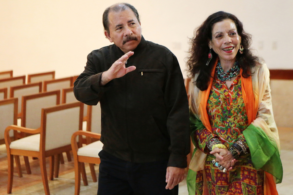 Nicaraguan President, Daniel Ortega and his wife Rosario Murillo wave to journalists on December 4, 2013 in Managua.