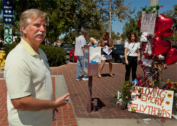 Ron Thomas, the father of victim, Kelly Thomas, stands next to a memorial for his son on Wednesday, Aug. 3, 2011, at the Fullerton Transportation Center in Fullerton, Calif.