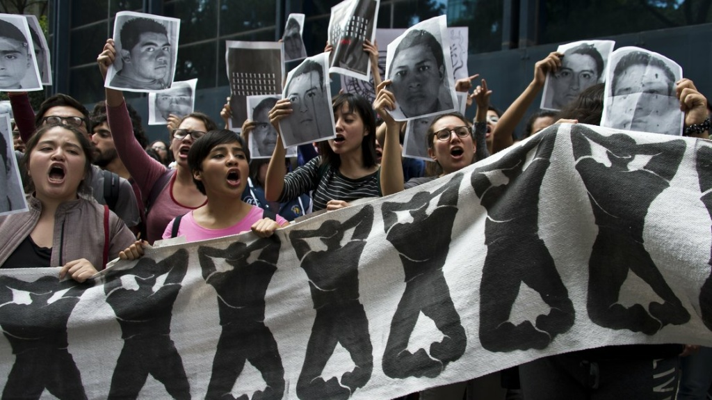 Students chant slogans in front of the Attorney General Office in Mexico City on Wednesday during a protest over the 43 students missing in Iguala, Guerrero State.
