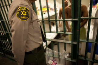 Ten Los Angeles County jail employees were relieved of duty Friday amid allegations a jail inmate was restrained in handcuffs for 32 hours without food.