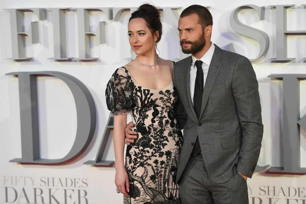 US actress Dakota Johnson (L) and Northern Irish actor Jamie Dornan (R) pose on the red carpet upon arrival at the UK premiere of Fifty Shades Darker in London on February 9, 2017.