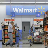 A man shops at a Walmart store in San Jose, Calif., in September. Wal-Mart on Thursday reported that its annual profits fell.