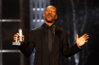 Comedian Eddie Murphy speaks onstage at The First Annual Comedy Awards at Hammerstein Ballroom on March 26, 2011 in New York City.