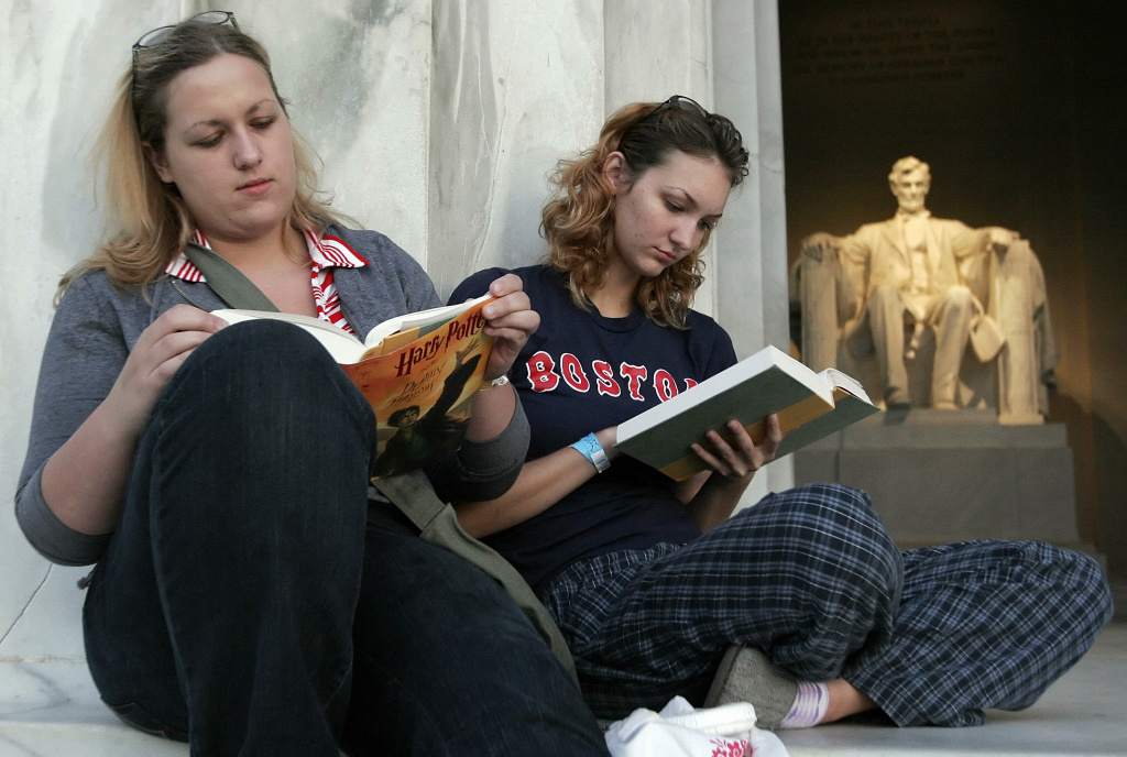 Jennifer Reckner (L), and Jessica Beegle (R), from Manassas, Virgina, read the final book in J. K. Rowling's Harry Potter series,