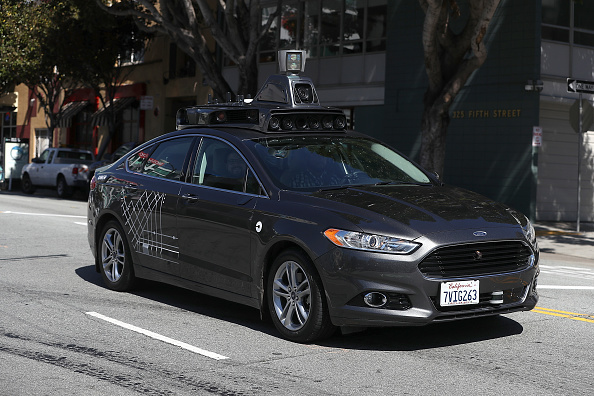 An Uber self-driving car drives down 5th Street on March 28, 2017 in San Francisco, California.