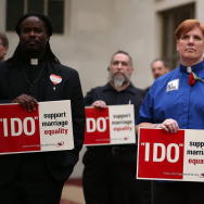 Same-sex marriage advocates protest outside the county clerk's office in San Francisco on Feb. 14.