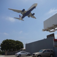 LAX billboard and plane landing