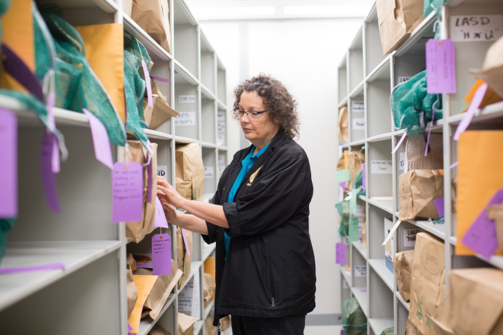 Denise Bertone looks at evidence in the Los Angeles County Department of Coroner forensics laboratory. Bartone is the leading coroner for deceased babies.