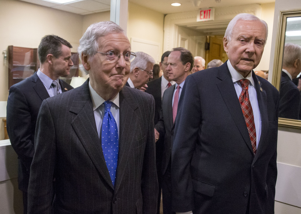 WASHINGTON, DC - DECEMBER 20: (L-R) Senate Majority Leader Mitch McConnell (R-KY) and Senate Finance Committee chairman Orrin Hatch (R-UT) arrive at the press conference after the senate vote of the tax reform bill on December 20, 2017 in Washington, DC. The Senate has passed the tax reform bill and it will return to the House of Representatives for final approval. (Photo by Tasos Katopodis/Getty Images)