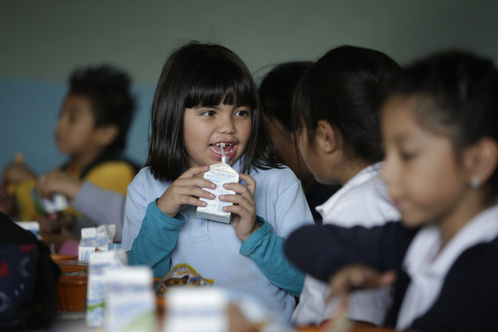 File: Hazel Loarca, 7, drinks her milk in the cafeteria area at Kingsley Elementary School, Tuesday, Jan. 13, 2015, in Los Angeles.