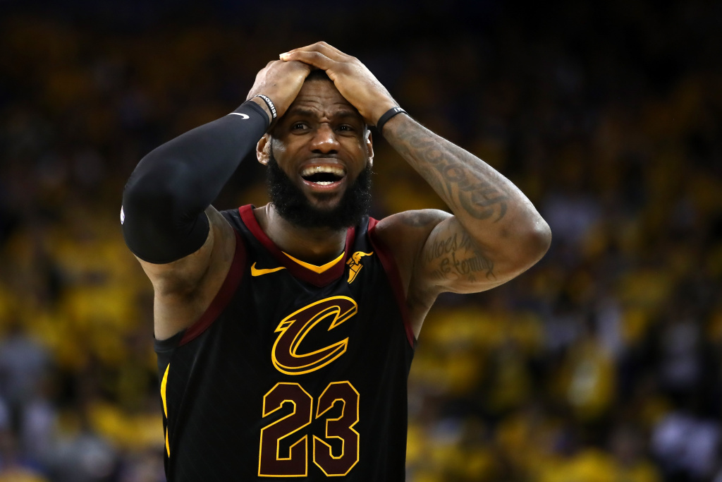 LeBron James #23 of the Cleveland Cavaliers reacts against the Golden State Warriors in Game 1 of the 2018 NBA Finals at ORACLE Arena on May 31, 2018 in Oakland, California.
