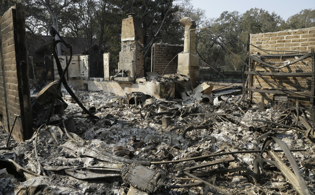 Remains of a home destroyed by wildfires seen Wednesday, Oct. 18, 2017, in Glen Ellen, California.