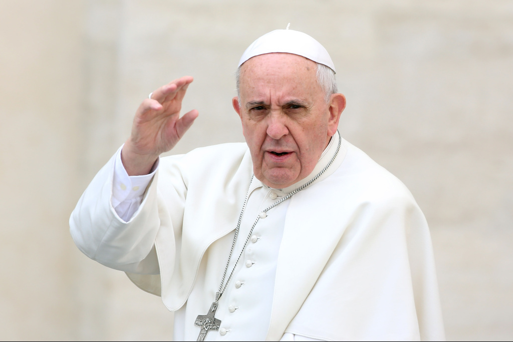 In this file photo, Pope Francis waves to the faithful as he holds his weekly audience in St. Peter's Square on March 19, 2014 in Vatican City, Vatican. Three of his family members perished in a car collision in Argentina Thursday.