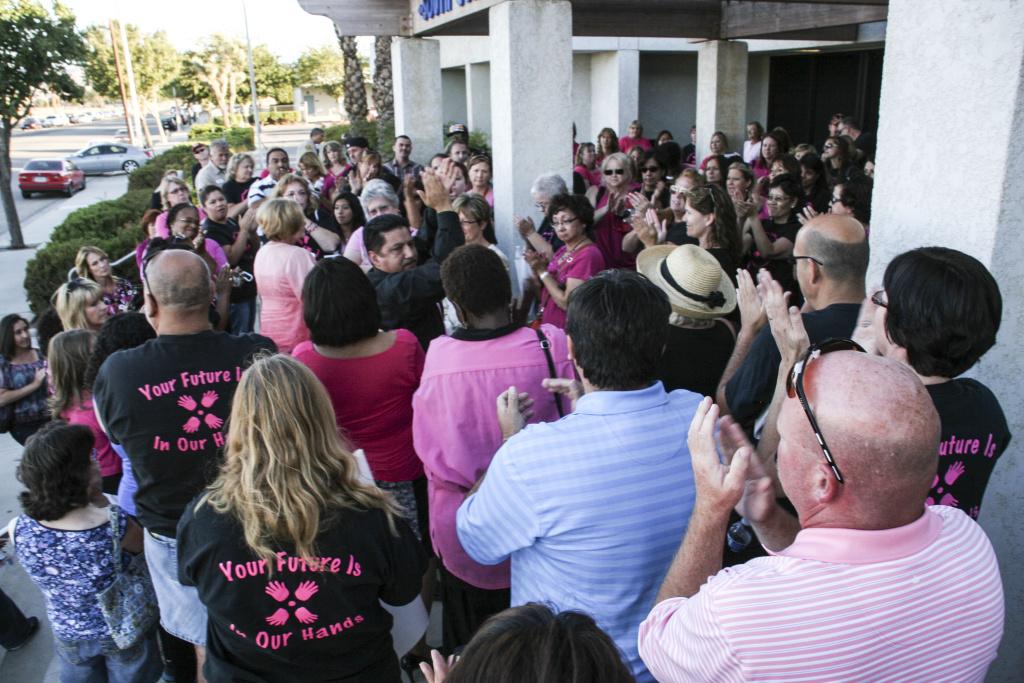 Palmdale Elementary Teachers Association members rally outside a July 16, 2013, school board meeting.