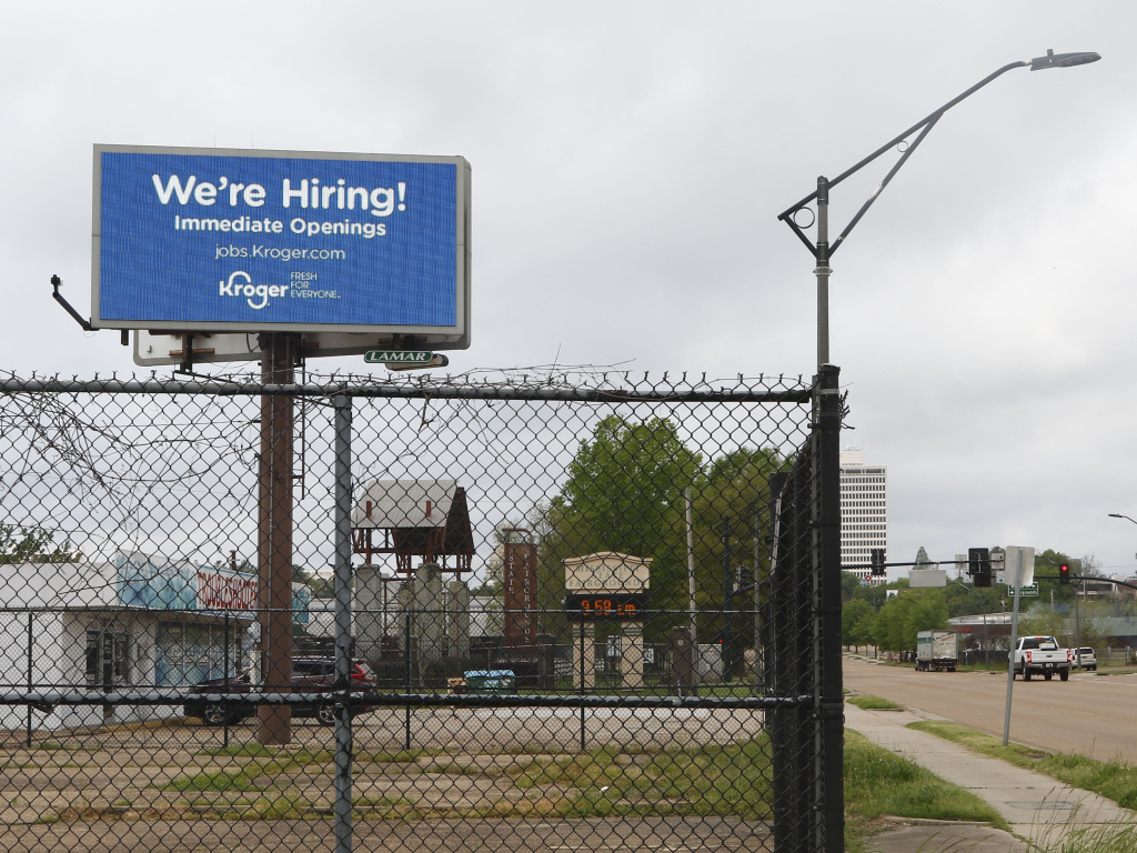 Kroger advertises it's hiring on a billboard in Jackson, Miss., on Monday.