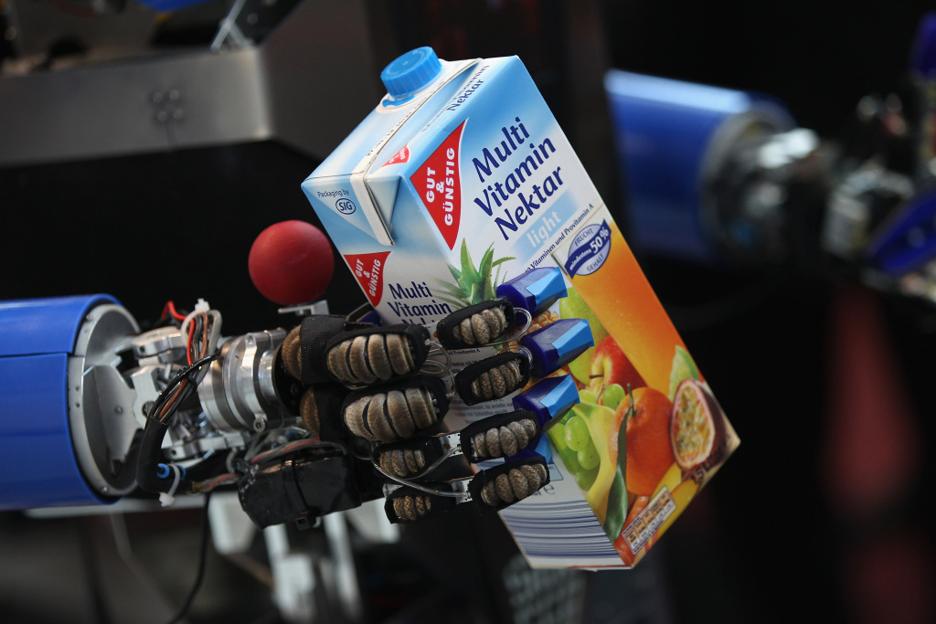 A robot developed by the Karlsruhe Institute of Technology retrieves a carton of juice in a presentation on the first day of the CeBIT 2012 technology trade fair. Advancements to humanoid robots could mean more fluid, accurate movement.