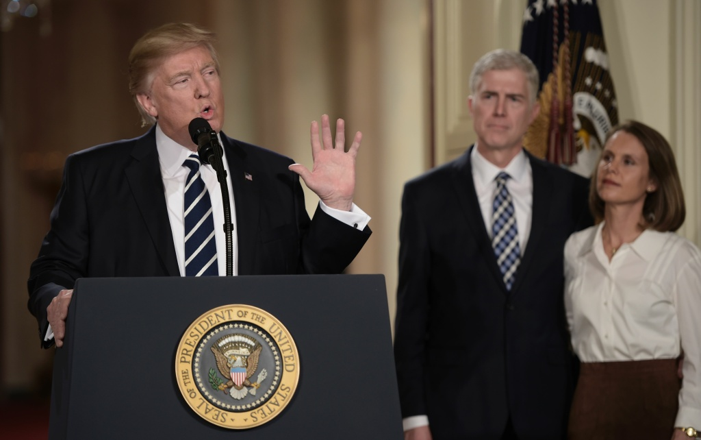 Judge Neil Gorsuch (C) and his wife Marie Louise look on, after President Donald Trump nominated him for the Supreme Court, at the White House in Washington, D.C., on Jan. 31, 2017.