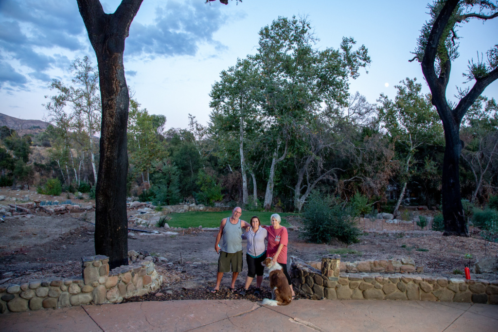 Jake Colborn, from left, Jessica Colborn, and Lorrie Colborn, who lost their home during the Thomas Fire, stand on their property in Upper Ojai.