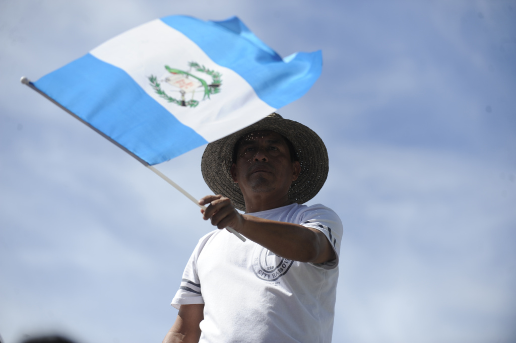 In this file photo, a man holds a Guatemalan flag during a parade for Independence Day in Guatemala City on September 15, 2012. Guatemalan government officials are planning to open a new consulate in San Bernardino by July, which could make it easier for consular staff to visit Guatemalan nationals who are awaiting or fighting deportation.