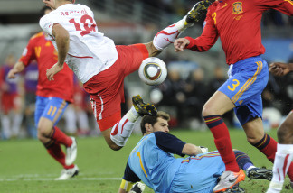 Switzerland's striker Eren Derdiyok (L, up) jumps over Spain's goalkeeper Iker Casillas (down) during their Group H first round 2010 World Cup football match on June 16, 2010 at Moses Mabhida stadium in Durban.