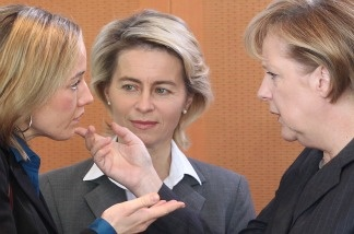 German Chancellor Angela Merkel (R) talks with Labour Minister Ursula von der Leyen (C) and Family Minister Kristina Schroeder (L) before a cabinet's meeting on October 27, 2010 in Berlin. Germany's cabinet agreed new draft laws against forced marriages and tough measures against immigrants who fail to integrate into society, amid a fierce debate about immigration in the country.