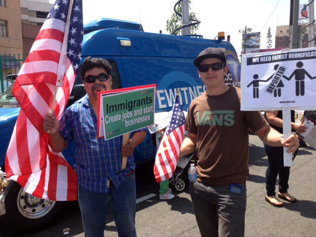 Heliodoro Cardenas, 25, right, and his father-in-law Felipe Ortiz, both of Montebello, at the May 1, 2013 May Day immigration rally in downtown Los Angeles. The current immigrant visa system relies heavily on family ties, but the Senate immigration reform bill suggests a shift away from this.